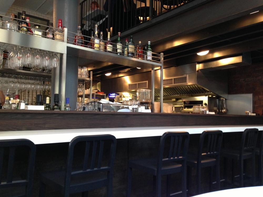 The open plan bar/kitchen