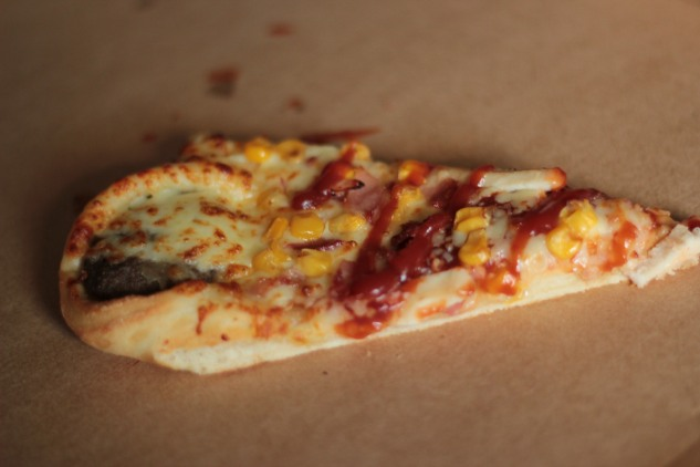 A slice of the pizza on its own.
