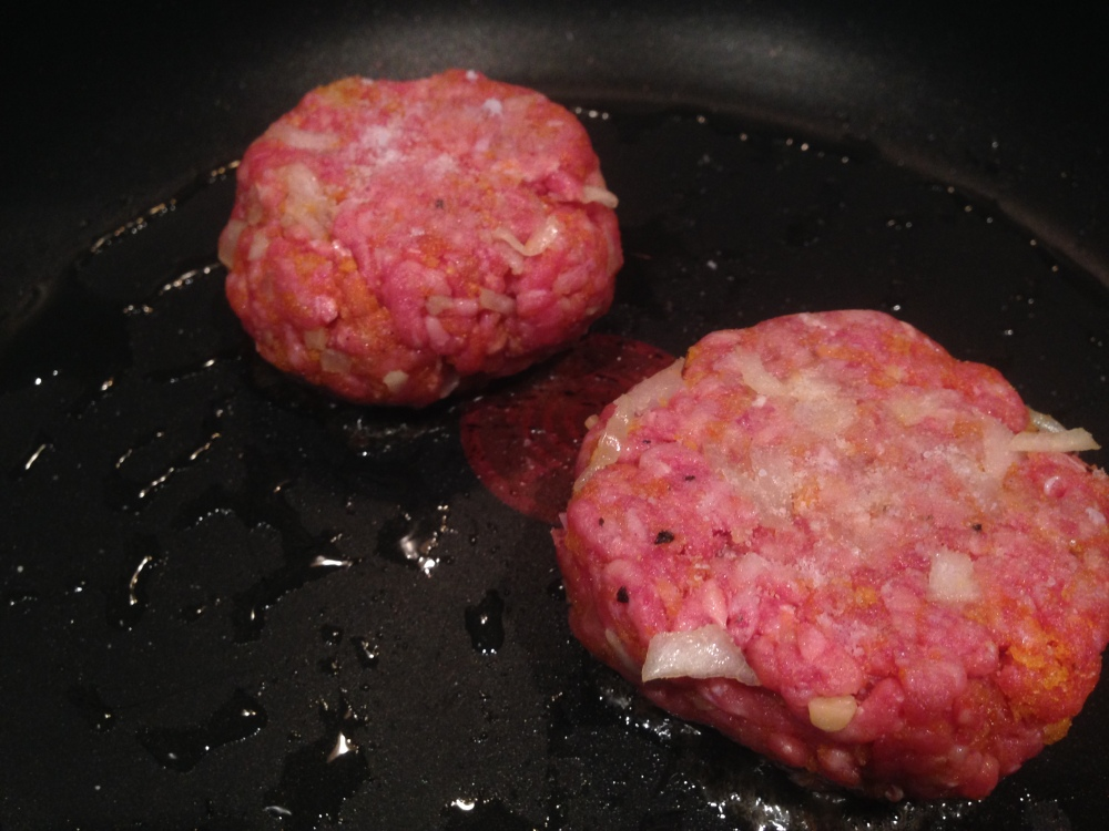 Cooking the patties.